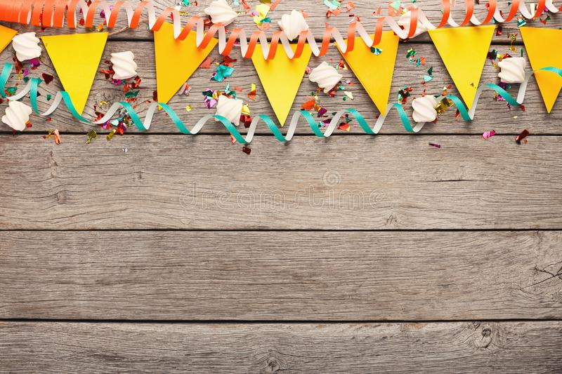 Colorful flags garland on wooden background royalty free stock image