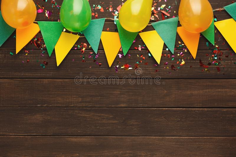 Colorful flags garland on wooden background royalty free stock photo