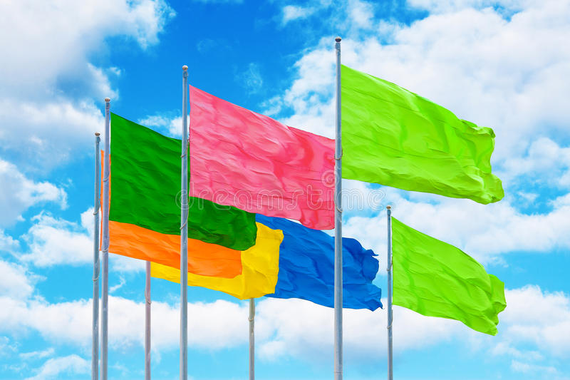 Colorful flags in wind against cloudy sky. Abstract background vector illustration