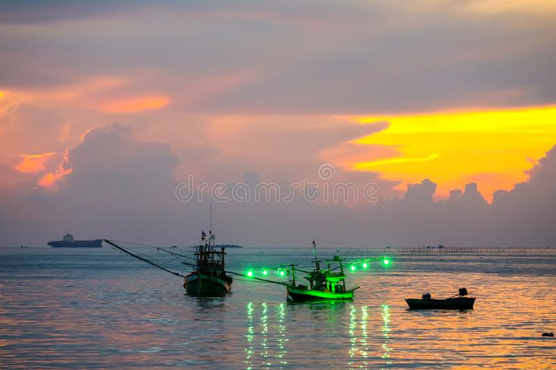 Colorful flame cloud sunset fisging boat on sea sky. Colorful flame cloud sunset fisging boat on sea and sky background abstract beauty blue bright cloudscape stock images
