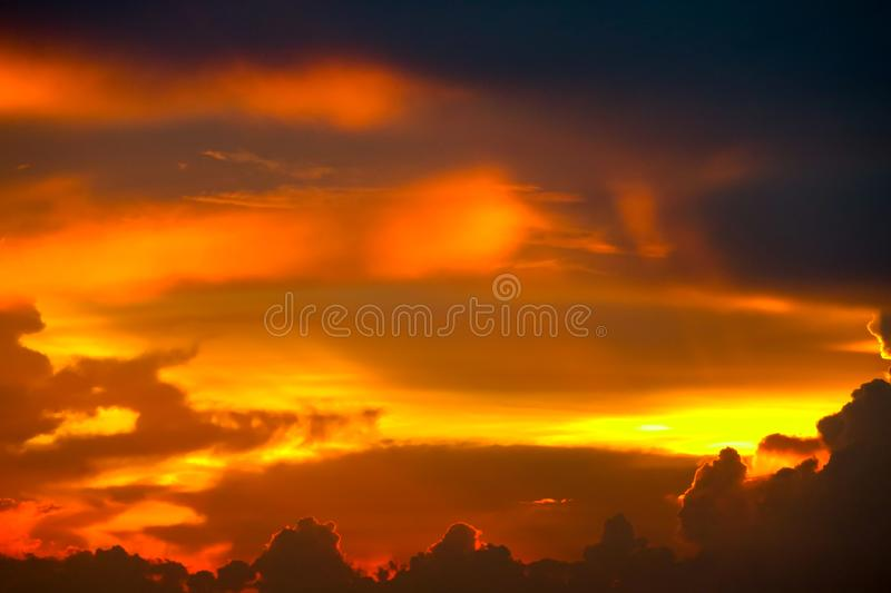 Colorful flame cloud sunset on sea and ray colorful sky. Background, abstract, beauty, blue, boat, bright, cloudscape, dark, dramatic, dusk, evening, fisherman stock photos