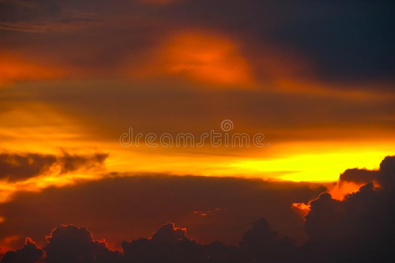 Colorful flame cloud sunset on sea and ray colorful sky. Background, abstract, beauty, blue, boat, bright, cloudscape, dark, dramatic, dusk, evening, fisherman royalty free stock images