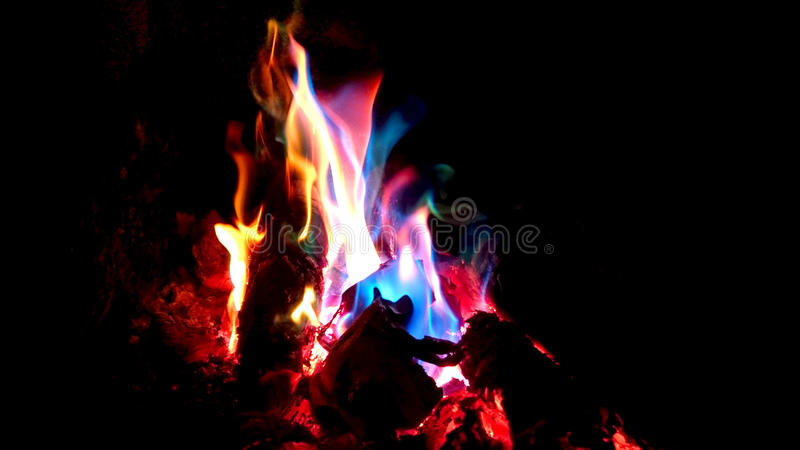 Colorful flames. Multicolor flames in the fireplace royalty free stock photos