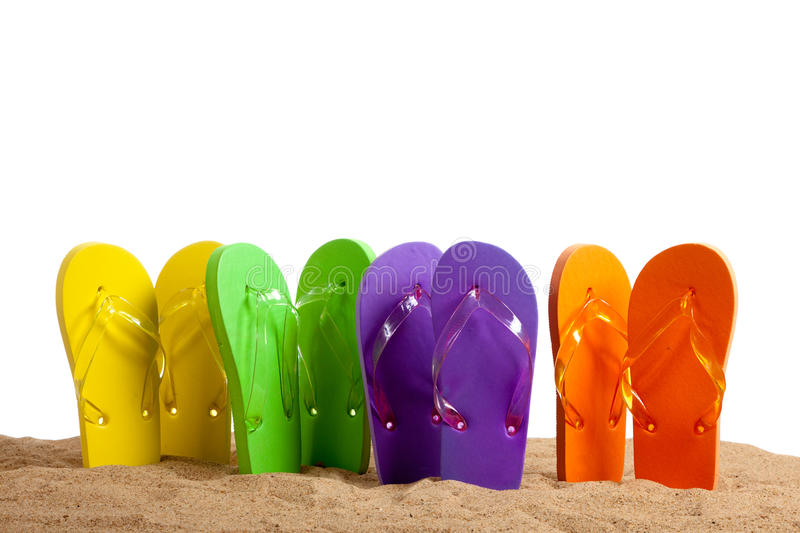 Colorful Flip-Flop Sandles On A Sandy Beach Royalty Free Stock Photo
