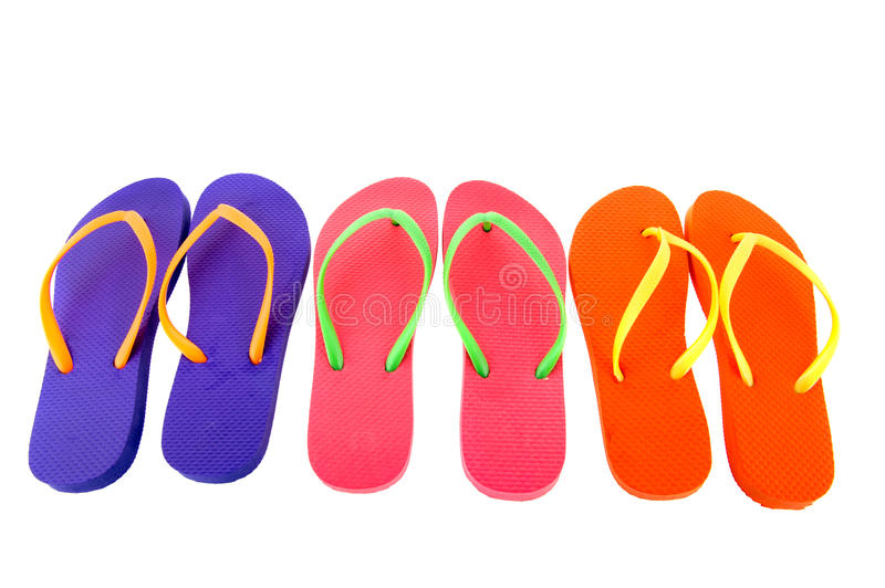 Colorful flip flops. Row colorful flip flops isolated over white background stock photo