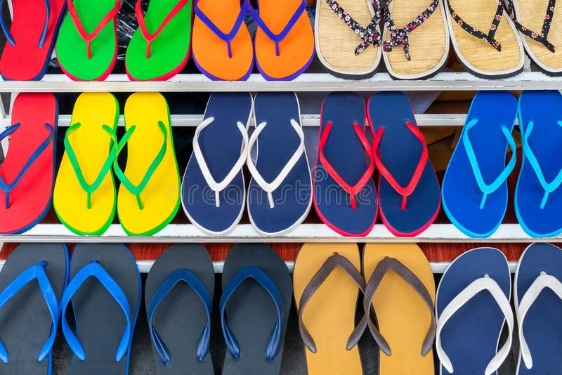 Colorful Flip Flops Sandals on Display For Sale in a Shop royalty free stock photography