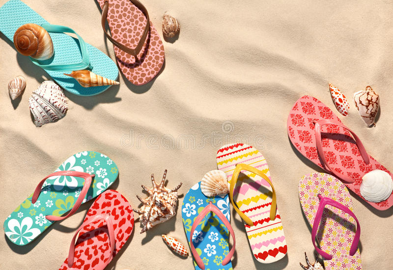 Colorful flip flops on the sandy beach in Hawaii, Kauai. royalty free stock images