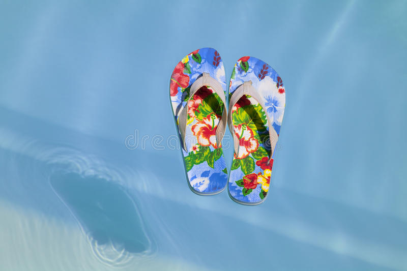 Download Colorful Flipflops Floating In A Swimming Pool Stock Photo - Image: 18338290
