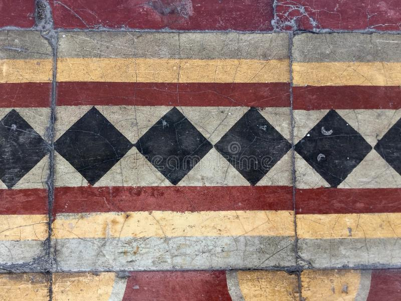 Colorful floor ceramics design. Colorful Vintage Style Ceramic Tile Pattern Texture and Background. Yellow, Red Black and White Tiles for Floors and Walls royalty free stock photos