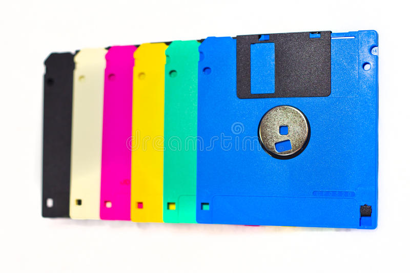 Colorful floppy discs data storage. Outdated technology of storing data with a range of primary colors stock photography