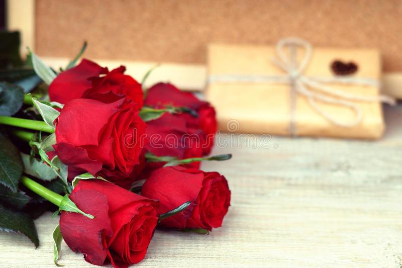 Colorful flower bouquet from red roses and gift box royalty free stock photo
