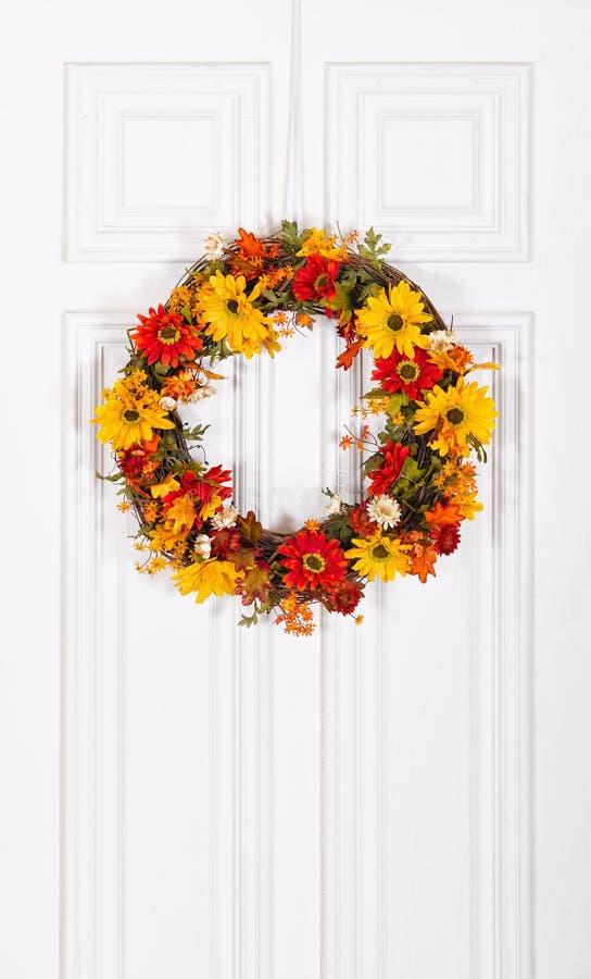 Flower wreath hanging on door stock images