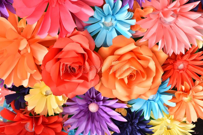 Colorful artificial Flower Background : Beautiful Colorful handmade of paper flower design for backdrop, decorate wallpaper in the royalty free stock image