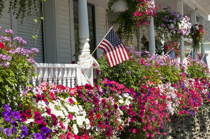 Flags and flowers on house porch stock photos