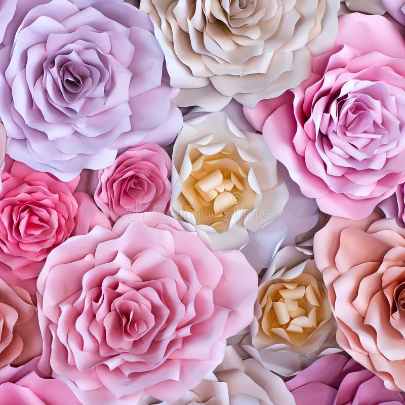 Colorful flowers paper background. Red, pink, purple, brown, yellow and peach handmade paper roses royalty free stock image