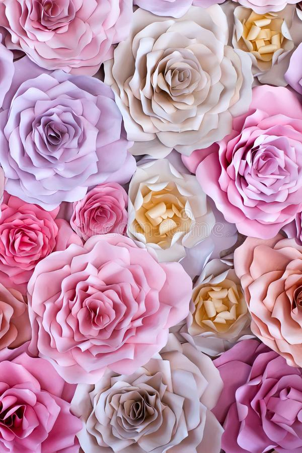 Colorful flowers paper background. Red, pink, purple, brown, yellow and peach handmade paper roses stock image