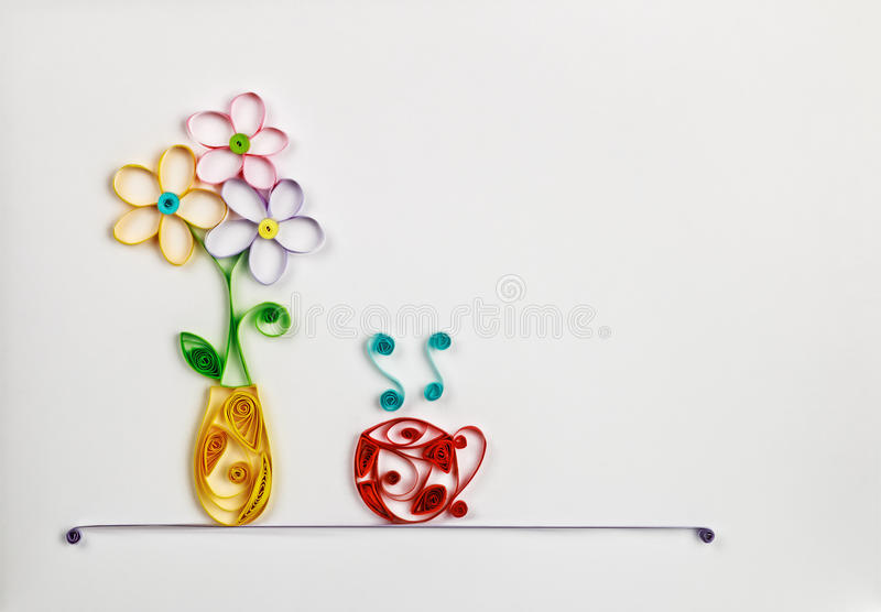Colorful flowers in a vase and a hot cup made of quilling stock photo