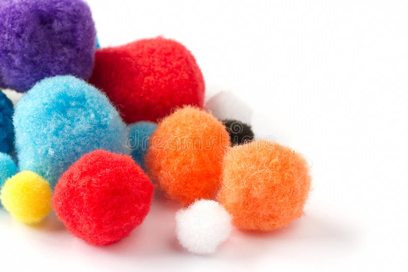 Colorful fluffy pom poms stock image