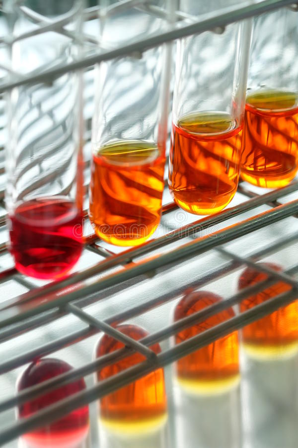 Colorful fluid in glass ware. For laboratory stock images