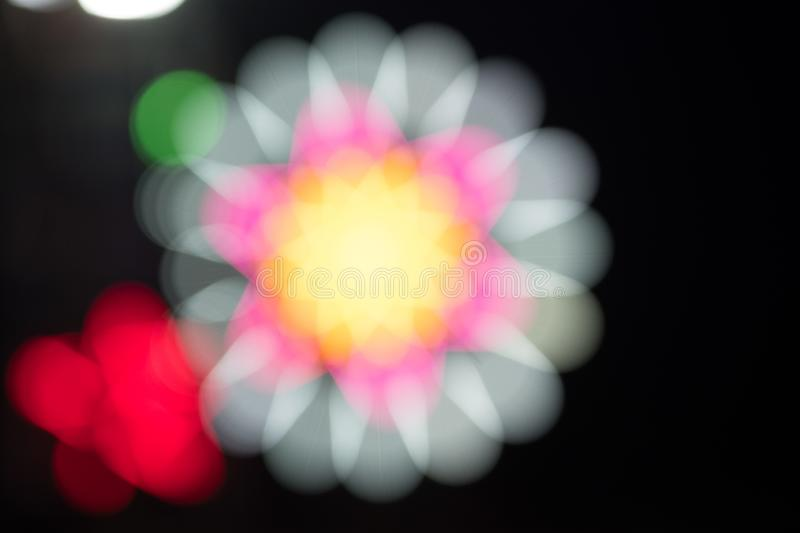 Colorful fluorescent with flower shape blur lights royalty free stock photography