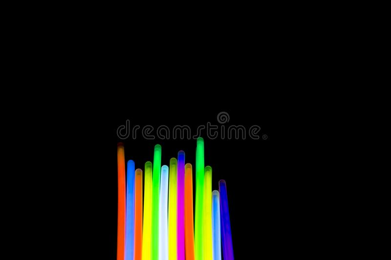 Colorful fluorescent light neon big glow stick on mirror reflection black background. Colorful fluorescent light neon glow stick on mirror reflection black royalty free illustration