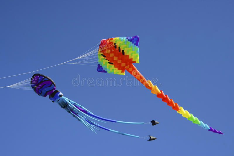 Download Colorful Flying Kites Against A Blue Sky Stock Photo - Image: 28928922