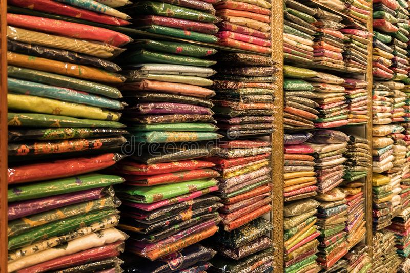 Colorful folded fabric sitting on a shelf in Little India royalty free stock photo