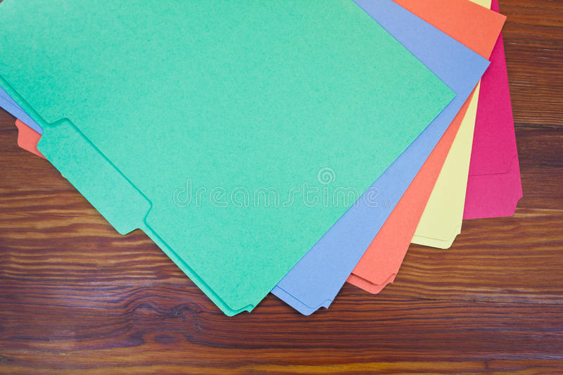 Colorful folders. Fanned out on a table to get organized stock photos