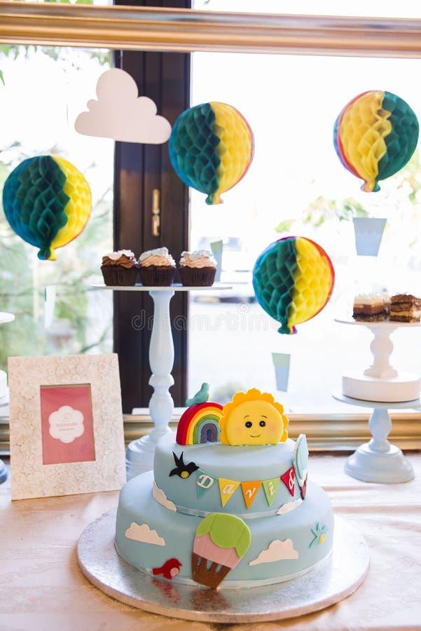 Colorful fondant cake. With little fondant figurines stock photos
