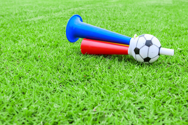 Download Colorful Football Hooter On Green Grass Stock Photo - Image: 33429324