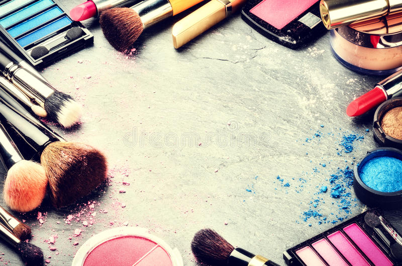 Colorful frame with various makeup products stock photography