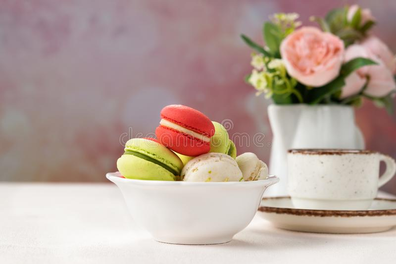 Colorful French or Italian macarons cookies on white bowl with copy space for background. Dessert for served with afternoon tea or royalty free stock photos