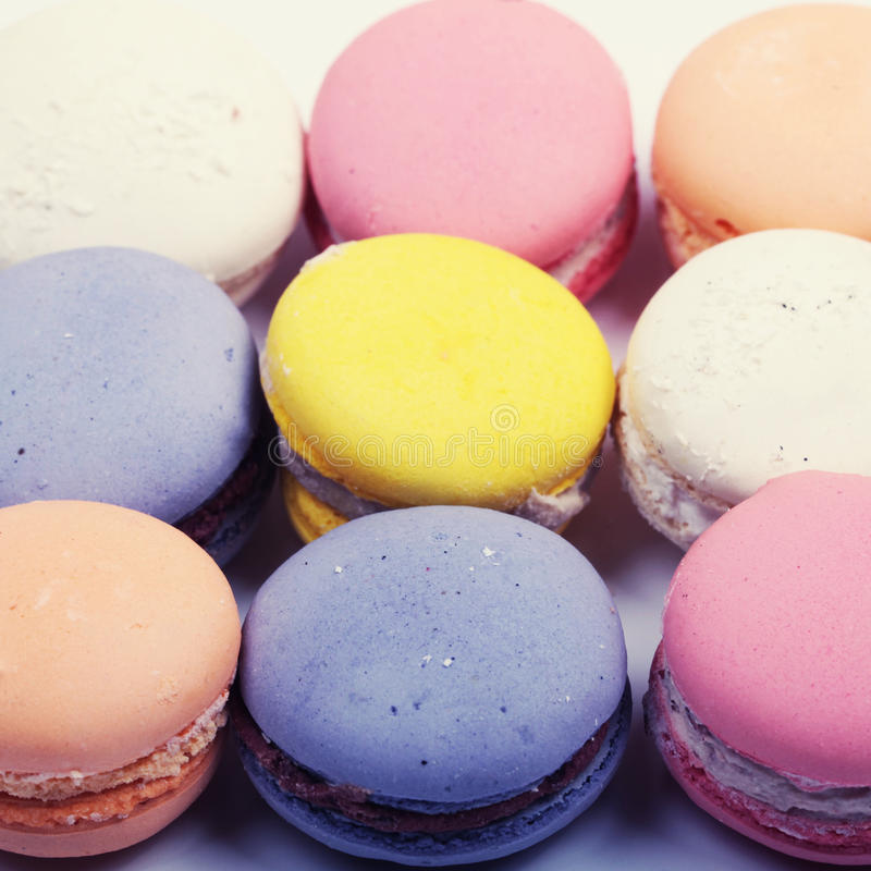 Colorful french macaron cookies close up, square image stock image