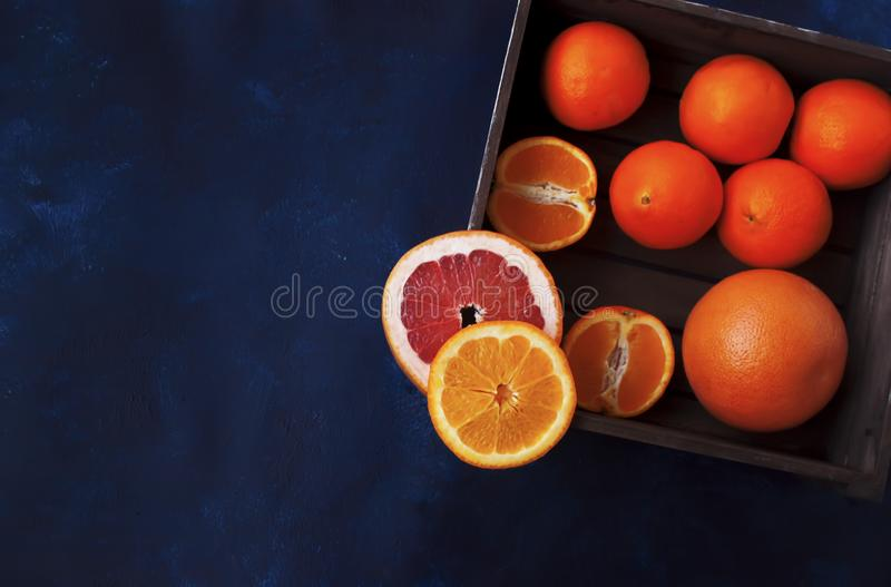 Colorful fresh citrus in basket royalty free stock photo