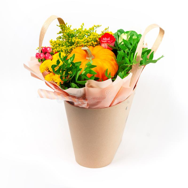 Colorful fresh festive bouquet of mixed  flowers in the decorative basket isolated on white background stock photos