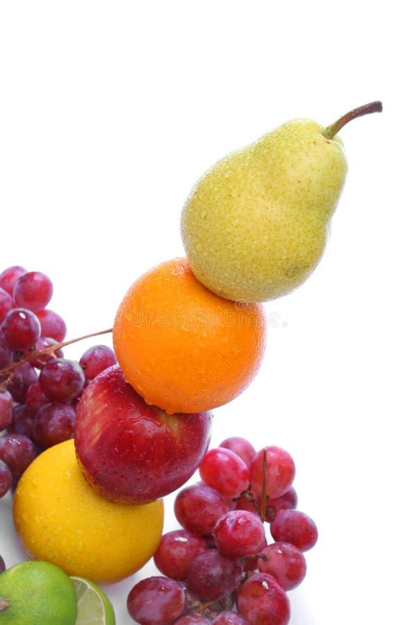 Colorful fresh fruits totem stock photo