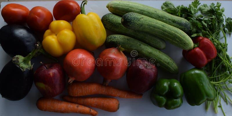 Fresh Vegetables and fruits rainbow arrangement stock photo