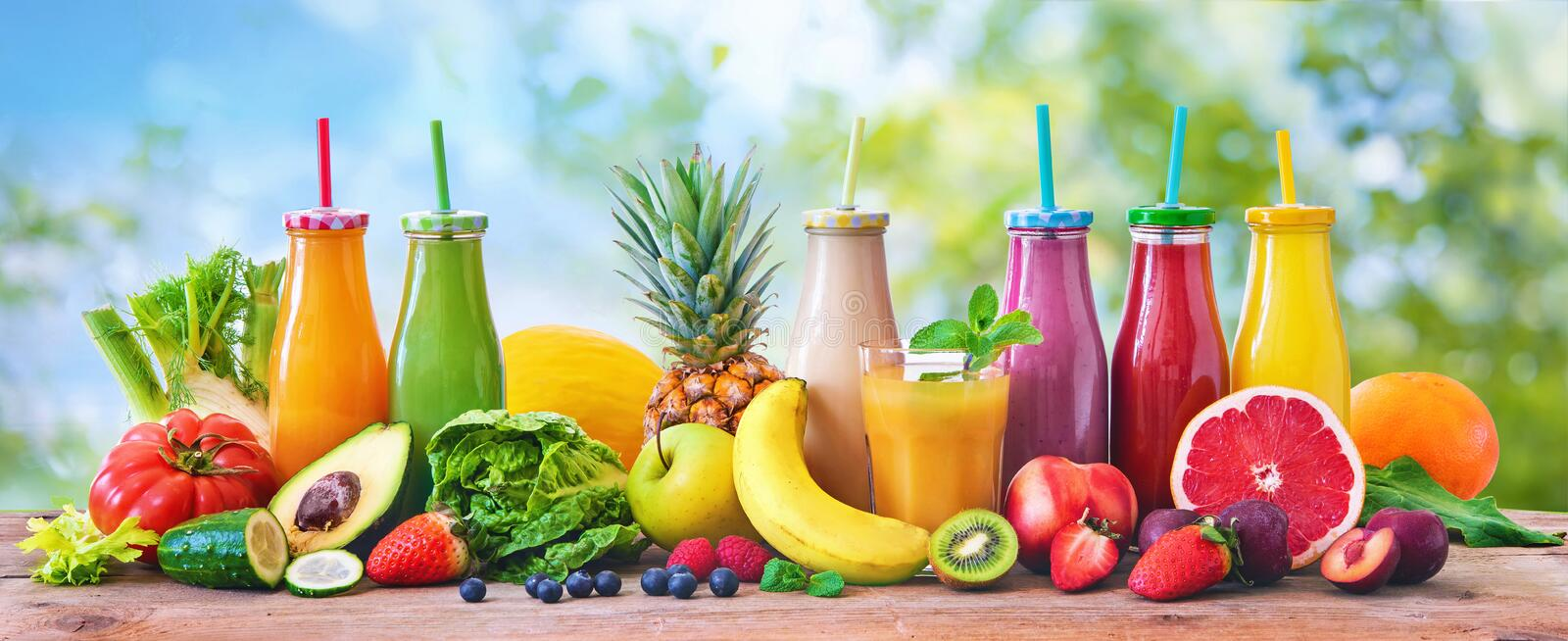 Colorful freshly squeezed fruits and vegetables smoothies with ingredients for healthy eating royalty free stock photography