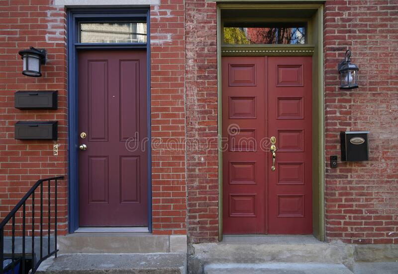 Colorful front doors. Of adjacent brick row houses royalty free stock image