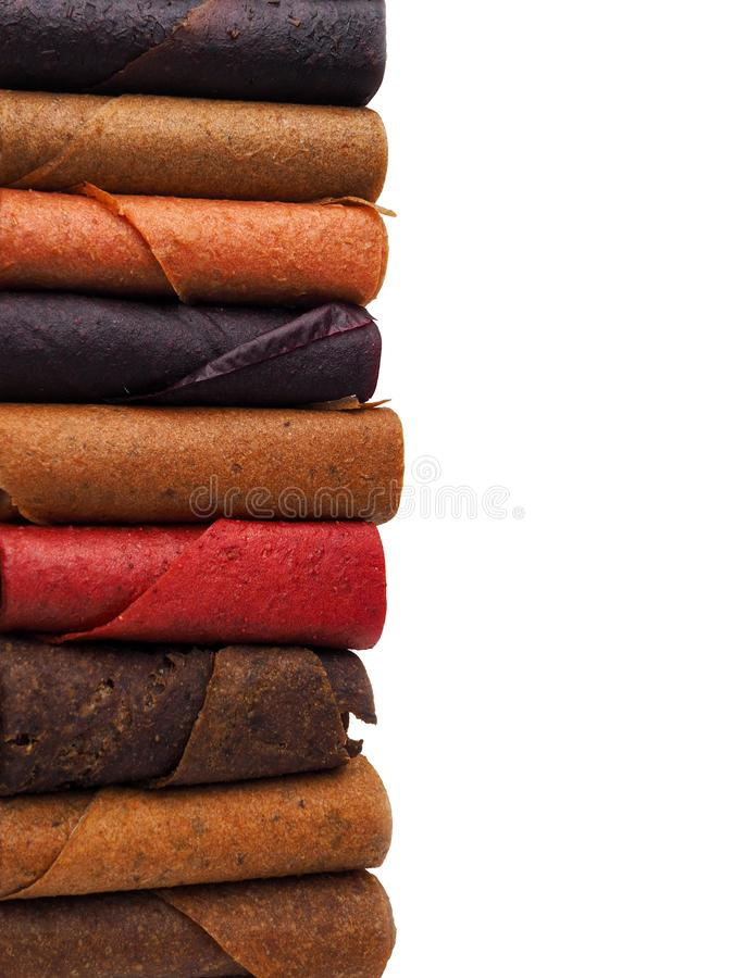 Colorful fruit leather rolls on white background stock photos