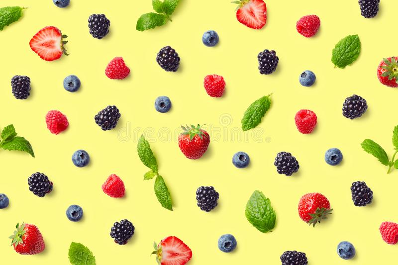 Colorful fruit pattern of berries and mint leaves stock images