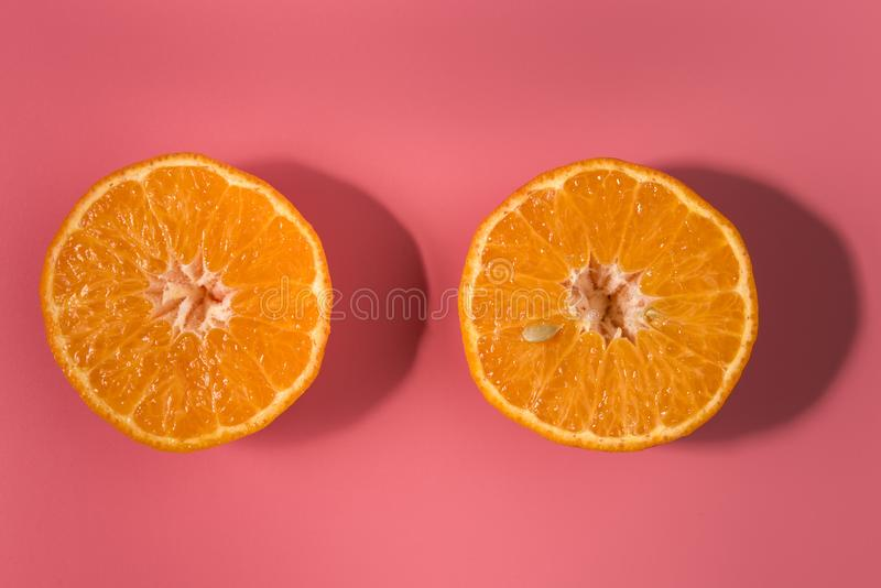 Colorful fruit pattern of fresh orange slices on pink background stock photography