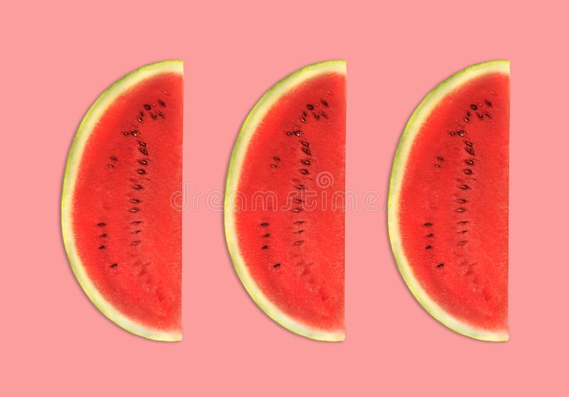 Colorful fruit pattern of fresh watermelon slices pink background. top view, flat lay. Trendy design stock photography