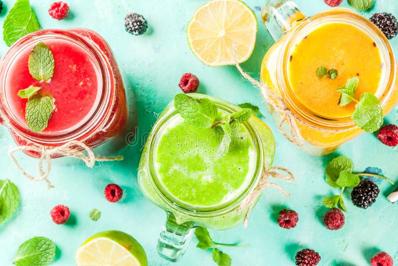 Colorful fruit and veggie smoothies royalty free stock photo