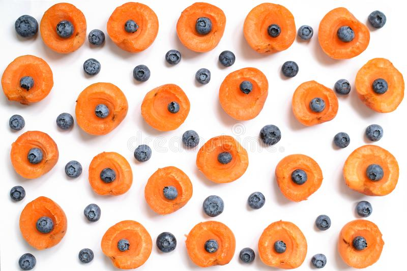 Colorful fruits of apricots and blueberries on a white background. royalty free stock image