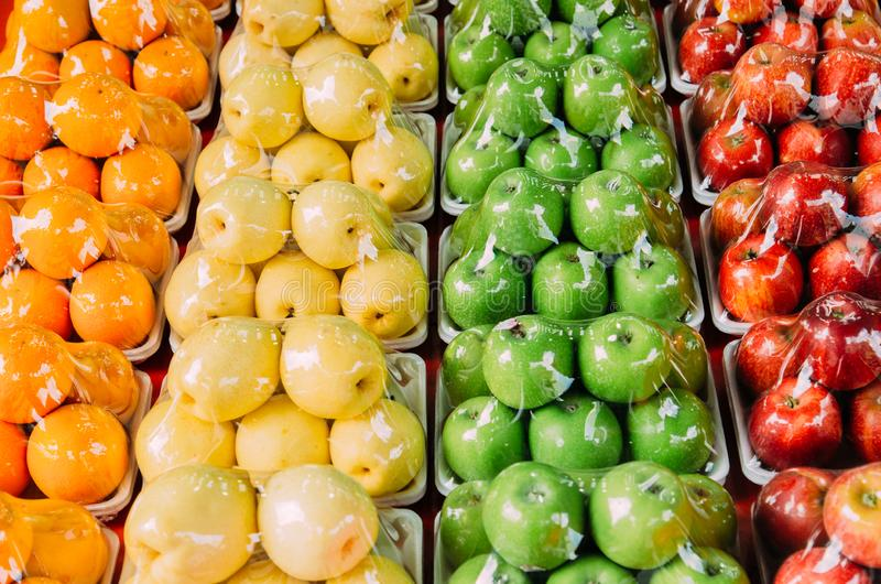 Colorful fruits display in supermarket royalty free stock image