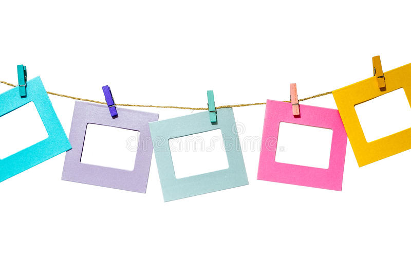 Colorful funny picture frames hanging on a rope with clothespins twine isolated royalty free stock photography