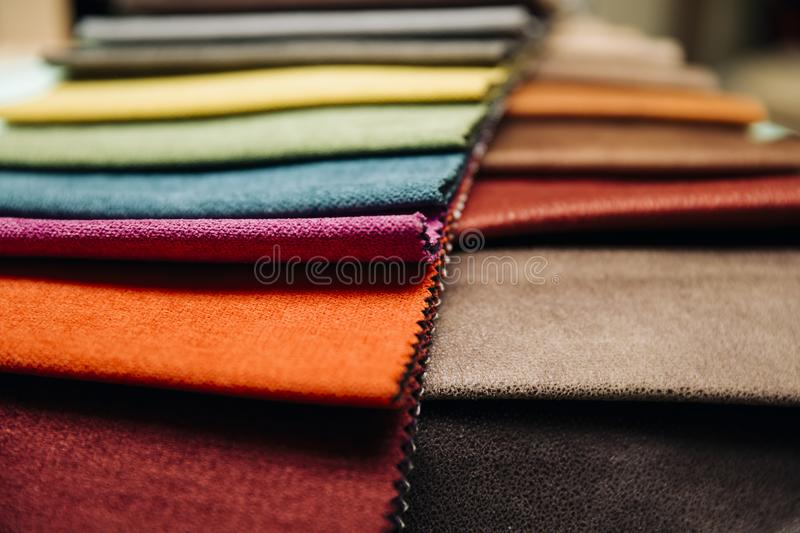 Colorful furniture covers. Closeup of the colorful furniture covers in the upholstery workshop stock photography