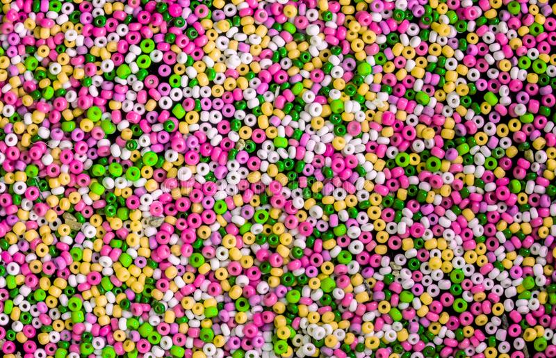 Colorful fusible plastic beads used for arts and craft. Colorful fusible plastic beads used for arts and craft, top view stock photo