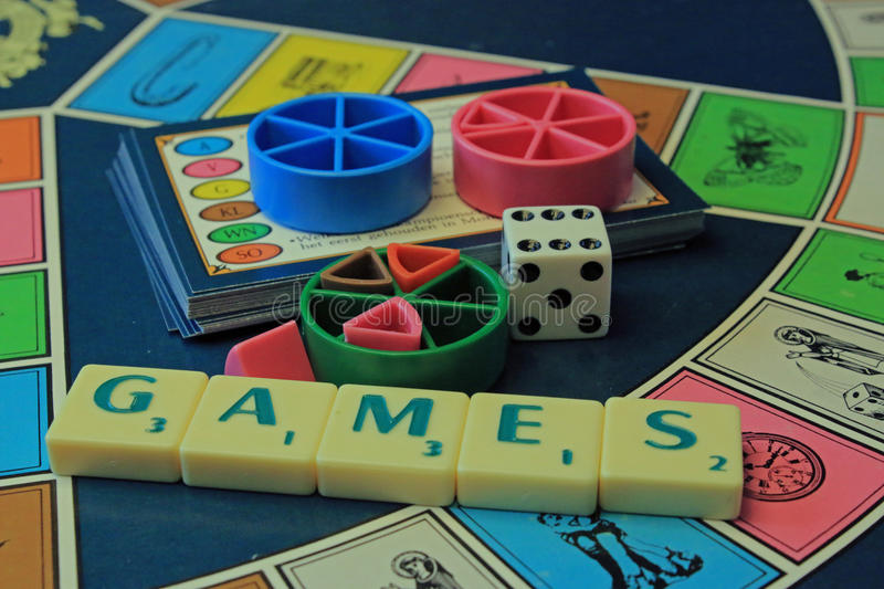 Colorful game board with letters, the word games and dice. royalty free stock photo